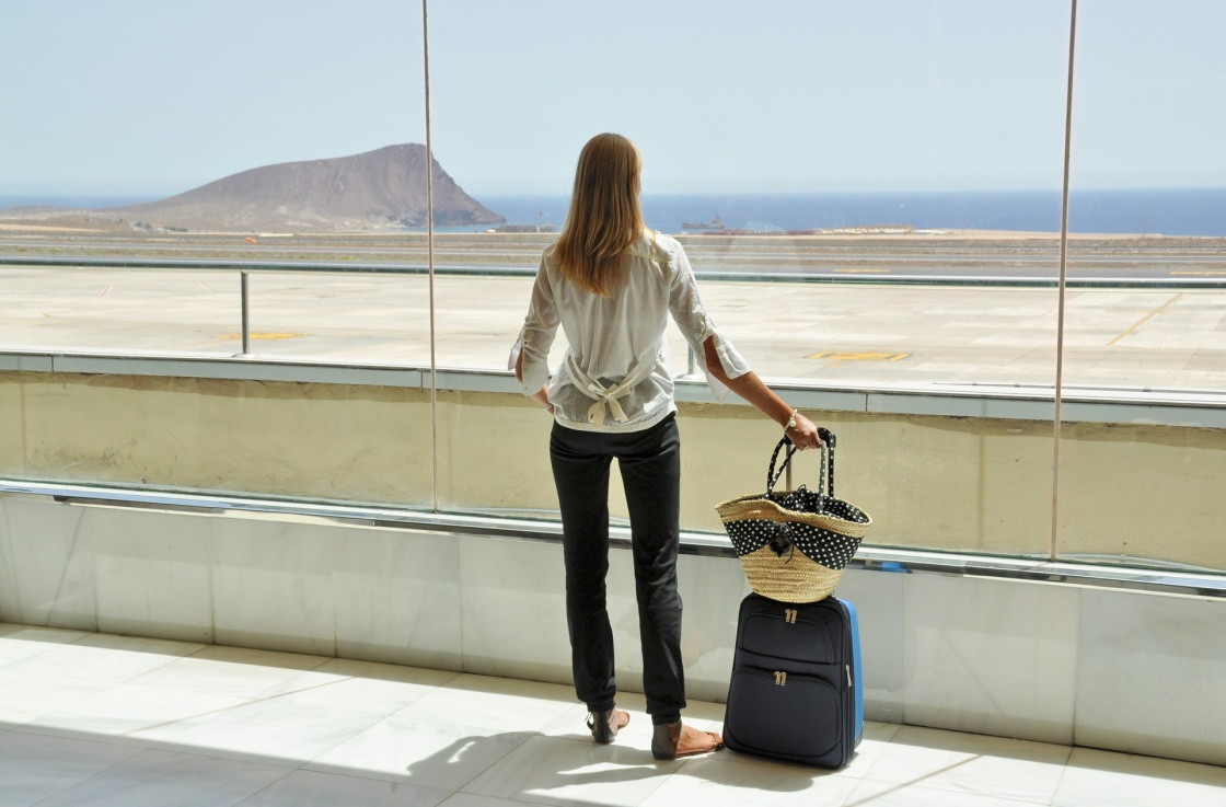 'Girl at the airport window looking to the Atlantic ocean. Tenerife, Canaries' - Tenerife